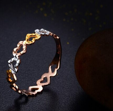 Buy 18K gold heart shaped ring of the new tri color female models